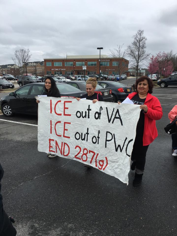 """protesters holding a sign that says """"ICE out of VA, ICE out of PWC, END 287g"""""""