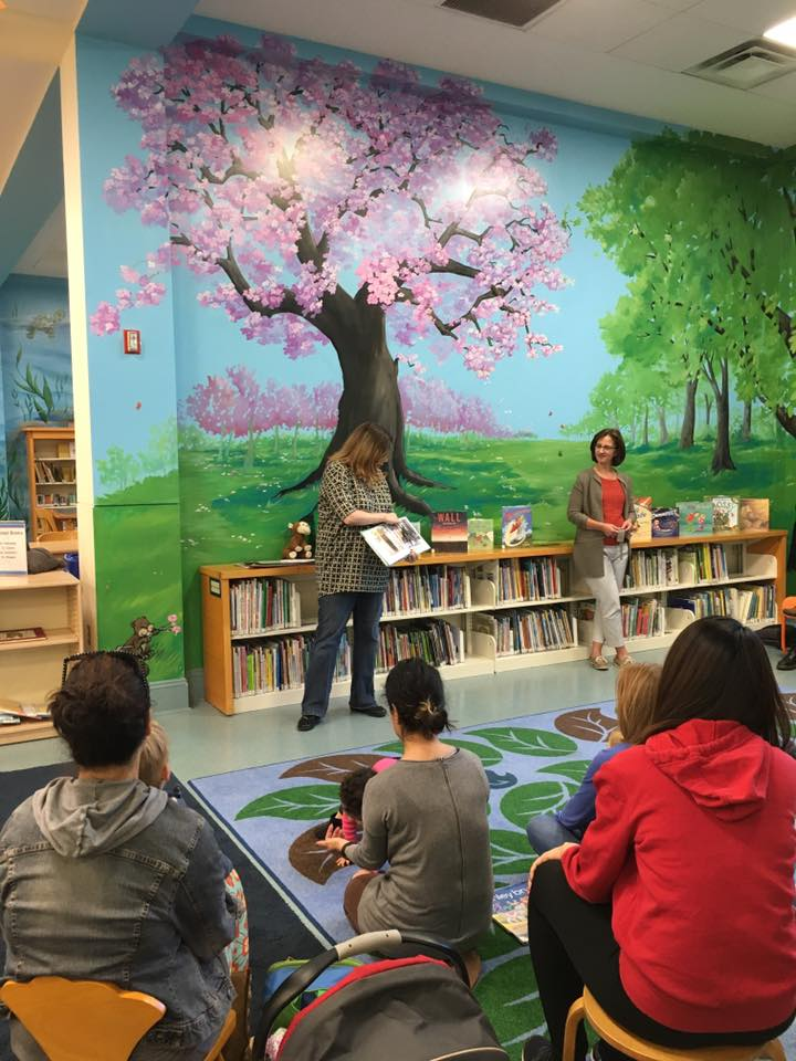 Parents with children at a racial justice story time at the library